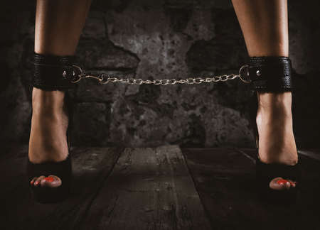 Sensual provocation of a woman with chained legs