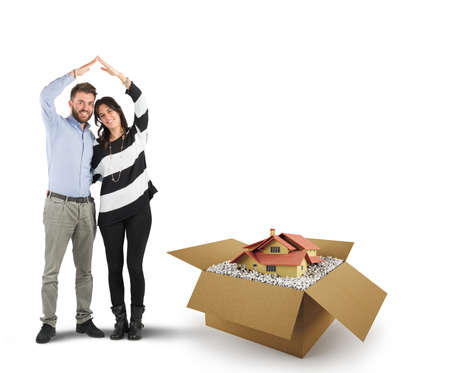 House in a cardboard box. Concept of buying a dwelling