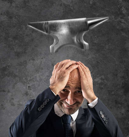 Difficult career in business with falling anvil