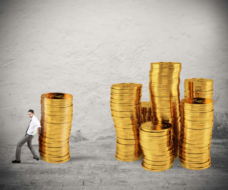 Businessman moves a pile of coins to a group of money. concept of difficulty to saving money