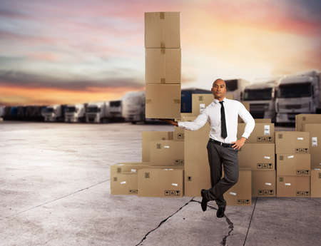 Businessman holds a pile of packages in a hand. concept of fast delivery