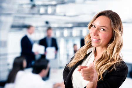 Businesswoman that indicates on the camera. Concept of people recruitment Banco de Imagens - 107617871