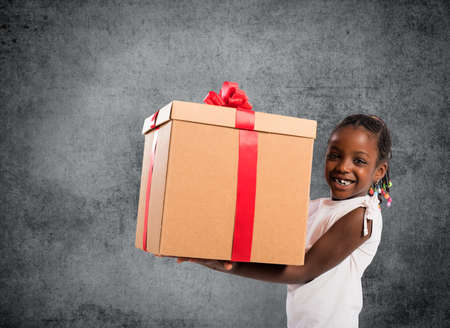 Happy little girl with a Christmas gift