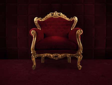 Poltrona di lusso rossa e oro in una vecchia stanza