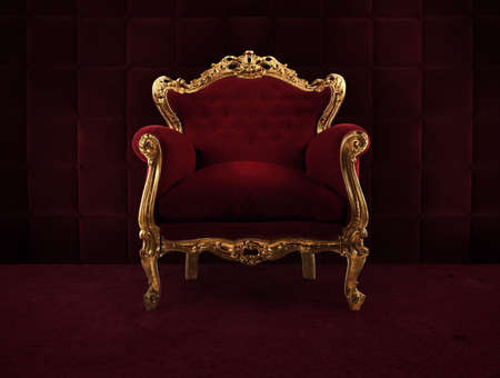 Red and gold luxury armchair into an old room Foto de archivo