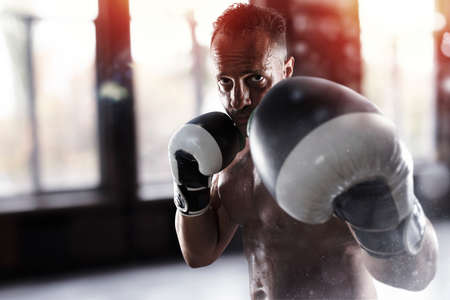 Man does boxing workouts at the gym Stock Photo