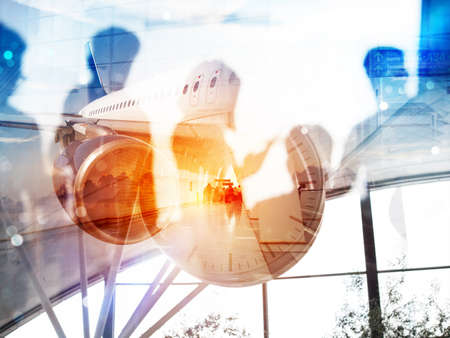 Take off of a modern aircraft and double exposure with silhouettes of passengers in the airport