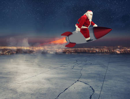 Fast delivery of Christmas gifts ready to fly with a rocket Stock Photo