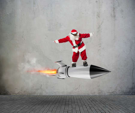 Fast delivery of Christmas gifts ready to fly with a rocket 스톡 콘텐츠