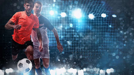 Close up of a challenge between soccer players with a soccer goal in the background Stock Photo