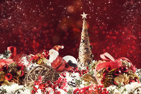 Shimmering Christmas decorations with tree, Santa Claus and candles