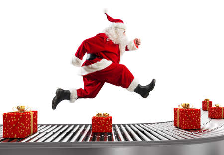 Santa Claus runs on the conveyor belt to arrange deliveries at Christmas time 写真素材