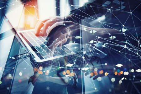 Business man works in office with laptop. Concept of internet network. double exposure Stock Photo