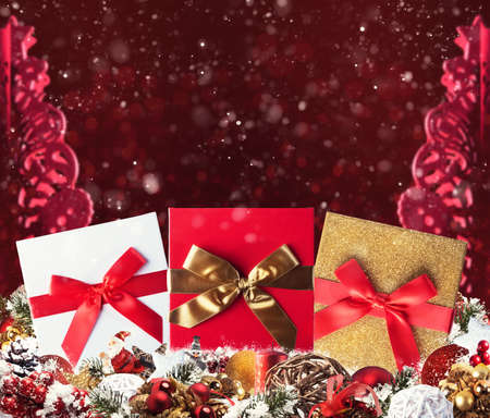 Christmas background concept. Shimmering Christmas decorations with gifts, Santa Claus and candles Stock Photo