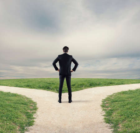 Choices of a businessman at a crossroads. Concept of decision Stock Photo
