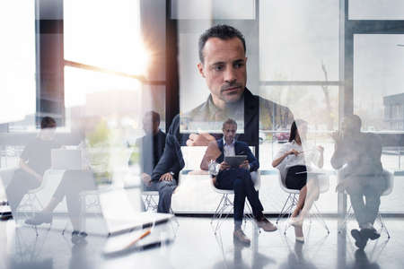 Business people connected on internet network with laptop and tablet. concept of startup company. double exposure Stock Photo