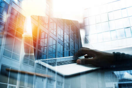 Businessman works in office with a laptop. Concept of internet sharing. double exposure Stock Photo