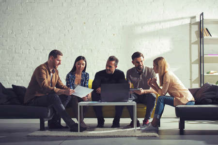 Business people connected on internet network with a laptop in a relax room. concept of startup company Stock Photo