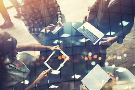 Business people work together with laptop and tablet. Concept of teamwork and startup. Double exposure