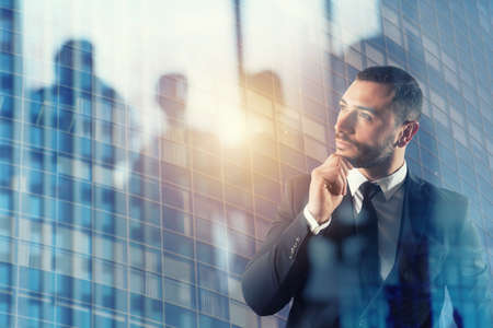 Businessman thinks new strategies to grow up the company. Standard-Bild - 113929196
