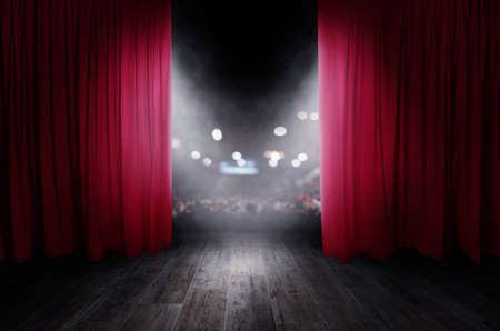 The red curtains are opening for the theater show