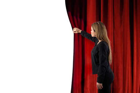 Woman open red curtains of the theater stage. blank space for your text Stok Fotoğraf