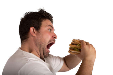 Insatiable and hungry man eating a sandwich