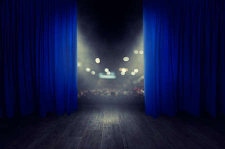 The blue curtains are opening for the theater show Stockfoto - 115371913