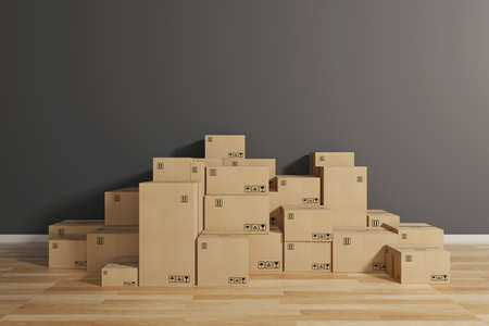 Stack of closed cardboard boxes wrapped with adhesive on the floor. Concept of moving and shipping