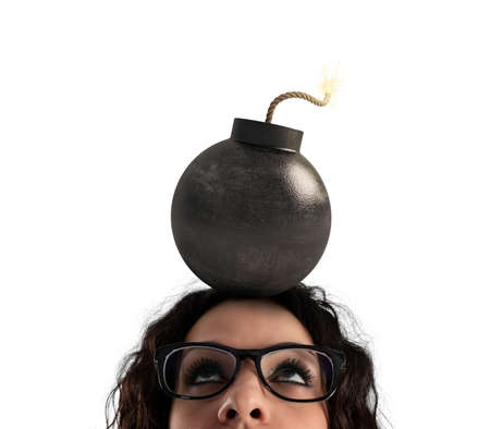 Businesswoman stunned by strong headache with a bomb over the head. Isolated on white background Stock Photo