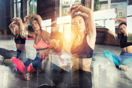 Young people do stretching at the gym. Double exposure Stock Photo
