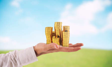 Businessman hold piles of money. Concept of success and company growth Stock Photo