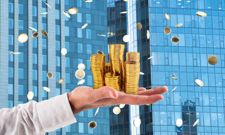 Businessman hold piles of money. Concept of success and company growth Фото со стока