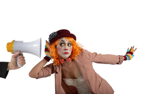Funny clown hears a megaphone with a message. Isolated on white background