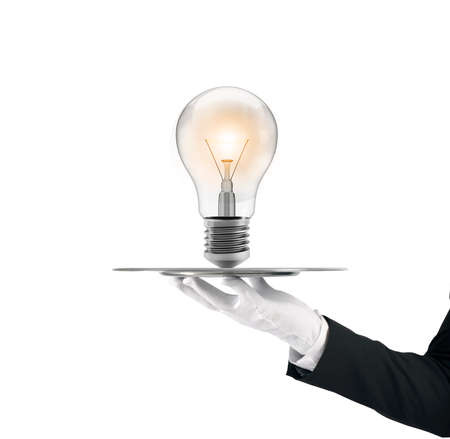 Waiter that holds a tray with a lightbulb. Concept big idea