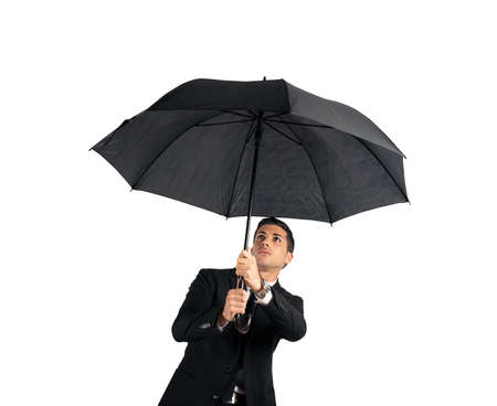 Businessman with umbrella. Concept of crisis. Isolated on white background