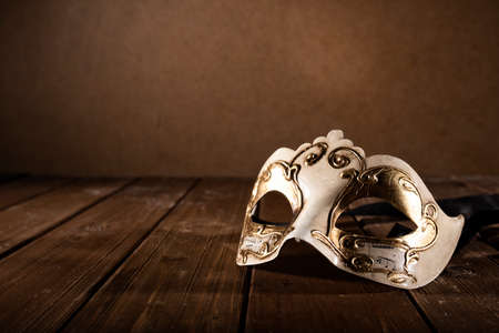 Stll life of a carnival mask on a wood floor