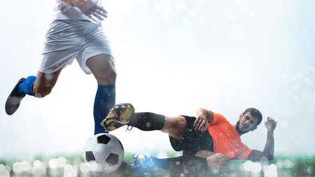 Close up of a football action scene with competing soccer players on white Banque d'images - 116930319
