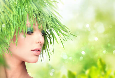 Nature beauty woman with fresh grass hair Stock Photo