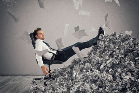 Businessman with paper sheet anywhere.