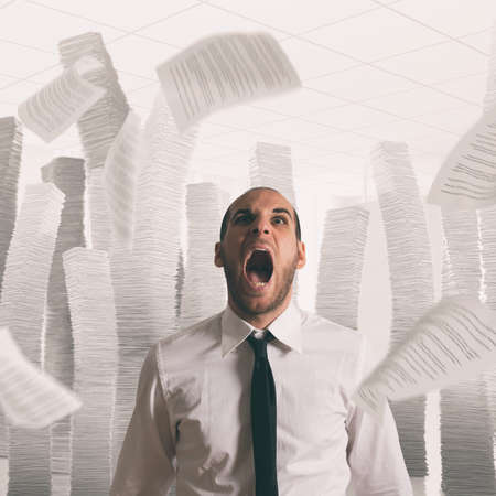 Businessman stressed and overworked screaming in office with flying paper sheets
