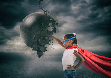 Power and determination of a super hero child against a wrecking ball