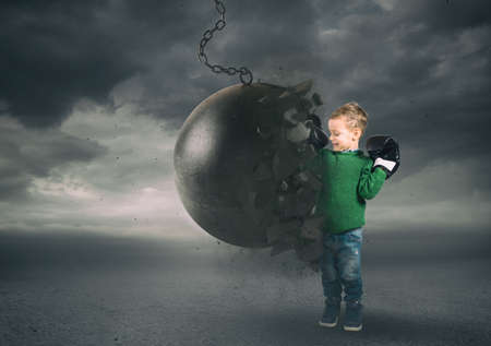 Power and determination of a child against a wrecking ball