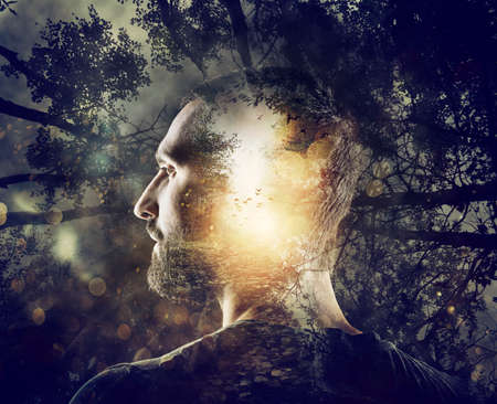 Boy with a mystical forest in mind. Double exposure