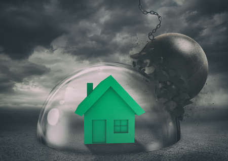 House safely inside a shield dome during a storm that protects it from a wrecking ball. Protection and safety concept 版權商用圖片