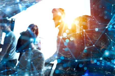 Business people collaborate together in office. Double exposure effects.