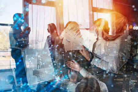 Team of people work together in office. Concept of teamwork and partnership. Double exposure. Stock Photo