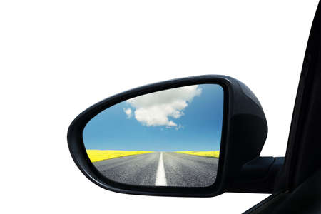 Wing mirror of a car with beautiful panorama reflected Stock Photo