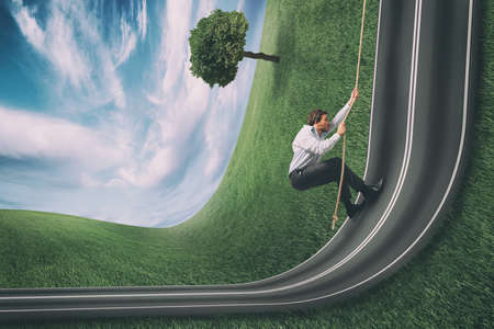 Businessman climbs a road bent upwards. Achievement business goal and difficult career concept