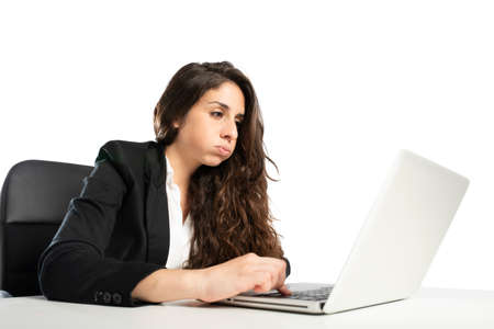Bored woman snorts in the office while working on the laptop Stok Fotoğraf - 120561851